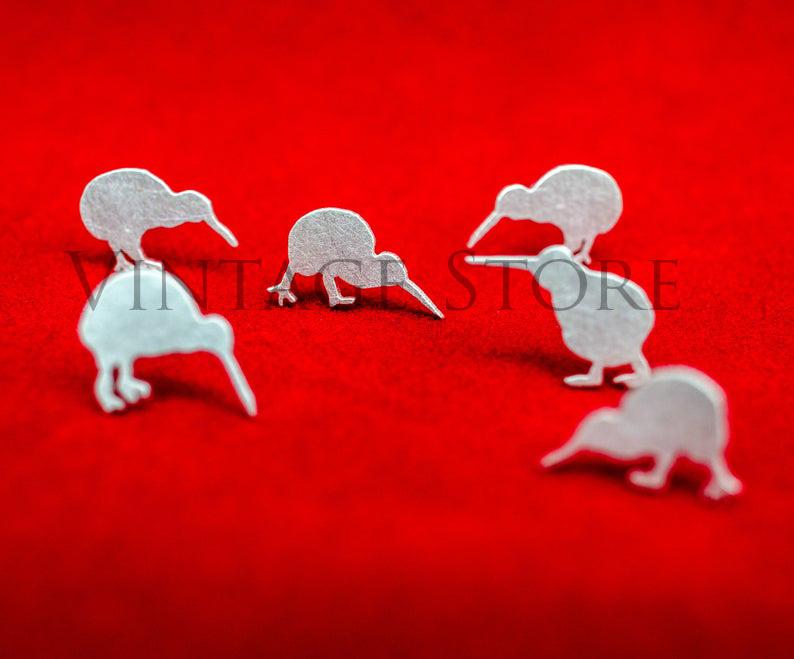 Kiwi silver stud earrings. Hand cut birds studs. Tiny kiwi silhouette earrings. Kiwi studs. Birds earrings